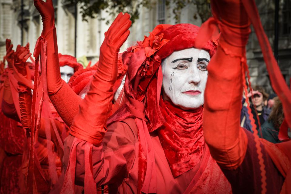 Activists sprayed red hands on government departments on...