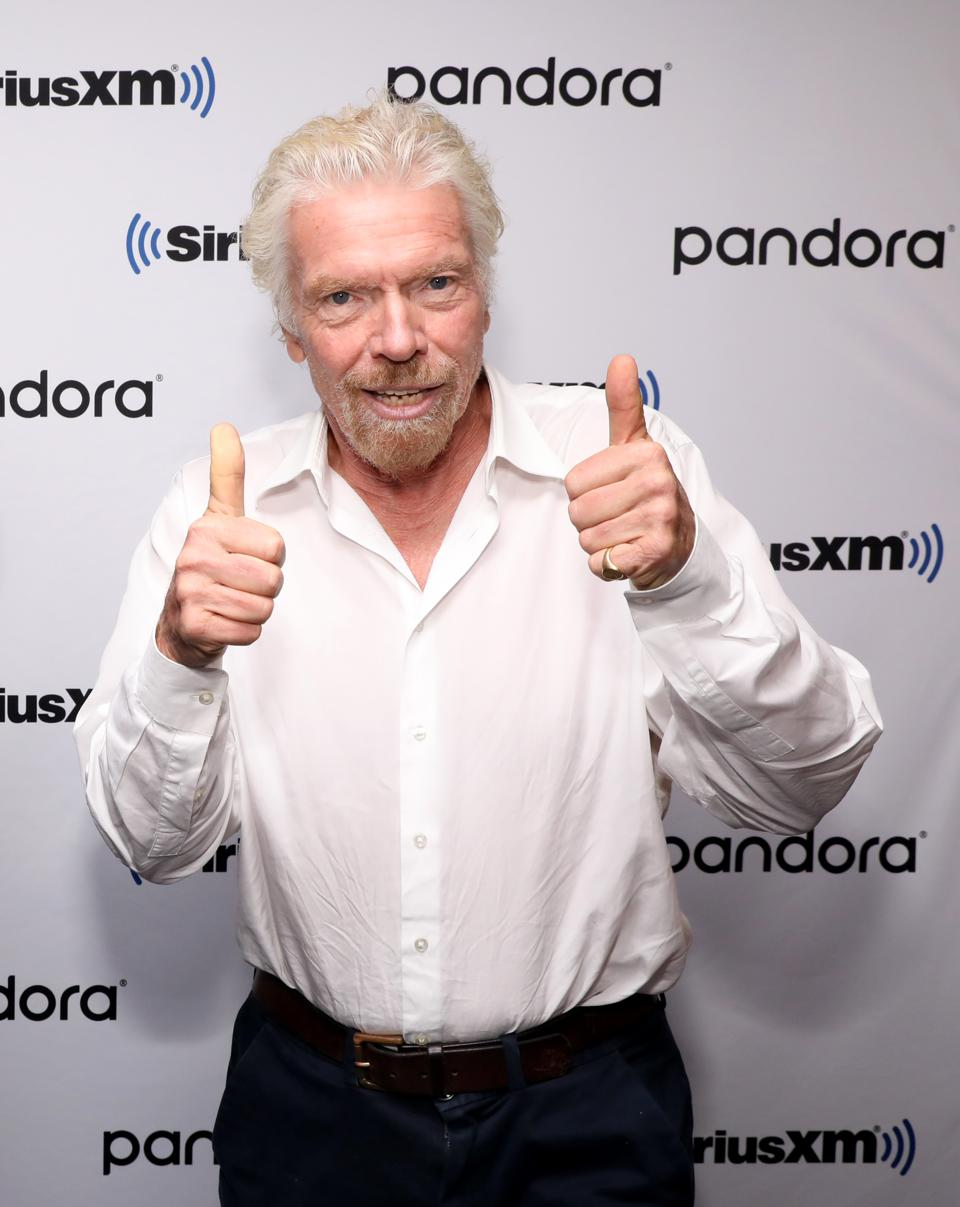 Sir Richard Branson And SiriusXM's John Fugelsang Special Broadcast Of ″Learning With Richard Branson″ With Guest David Miliband