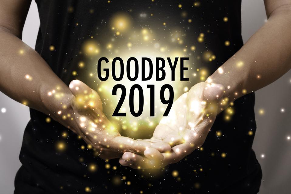 Goodbye 2019 with hand.