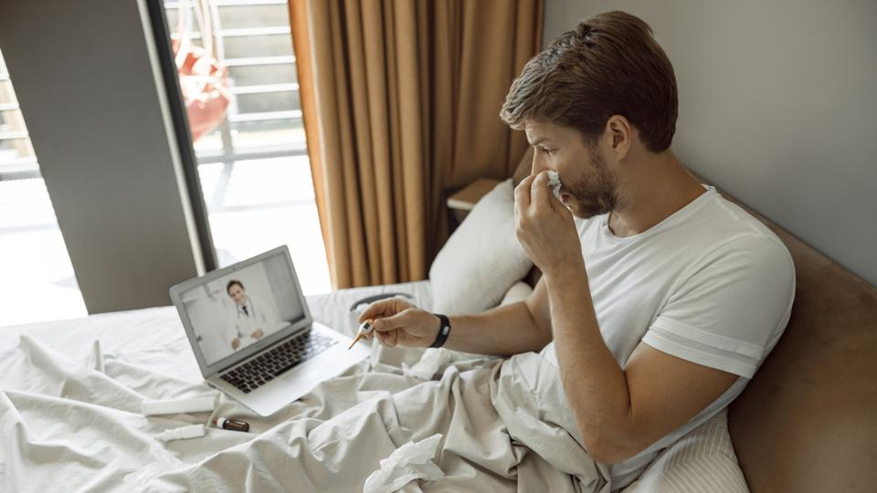Man making a video call to his doctor