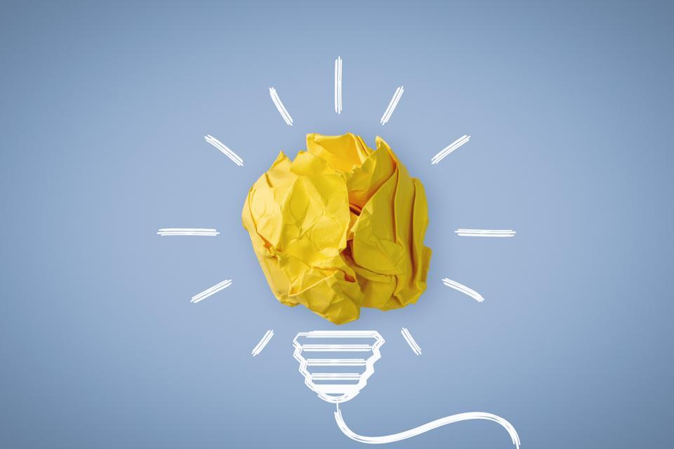 New Idea. Crumpled Paper Ball Glowing Bulb Concept.