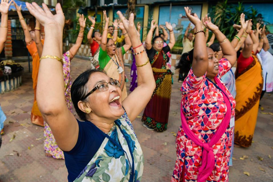 Senior People enjoy laughter yoga in Kolkata, India