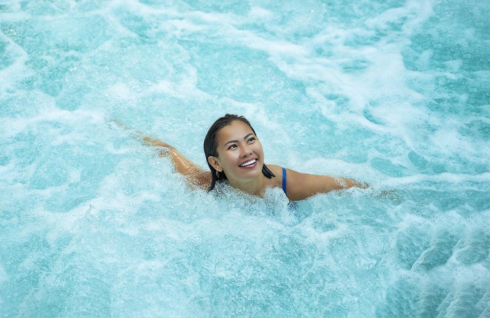 Woman in whirlpool or swim spa