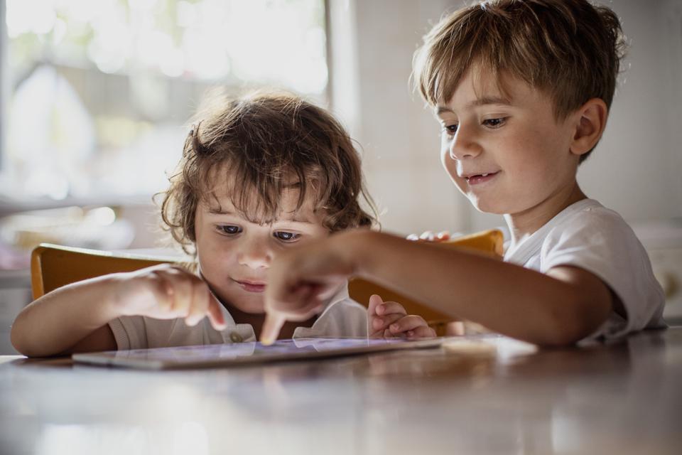 Kids using a digital tablet