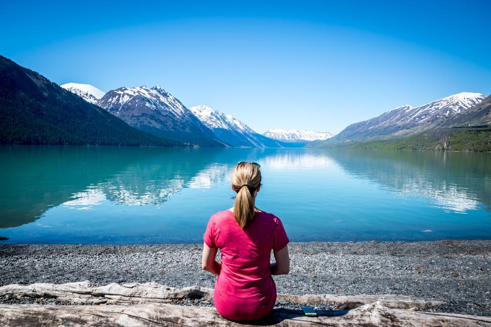 Woman looking at lake in Alaska