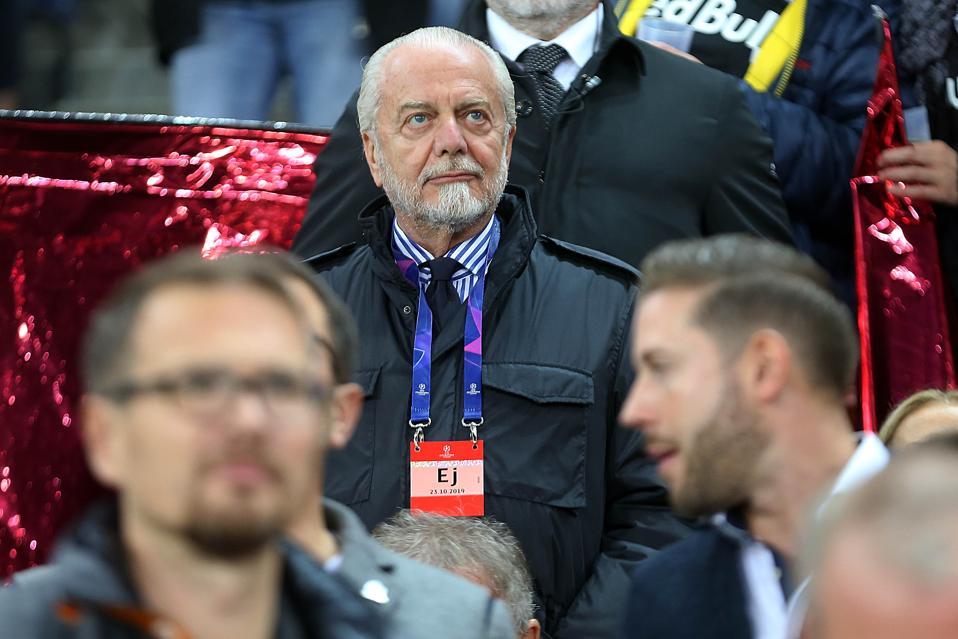 Napoli's chairman Aurelio De Laurentiis stands on the stage...
