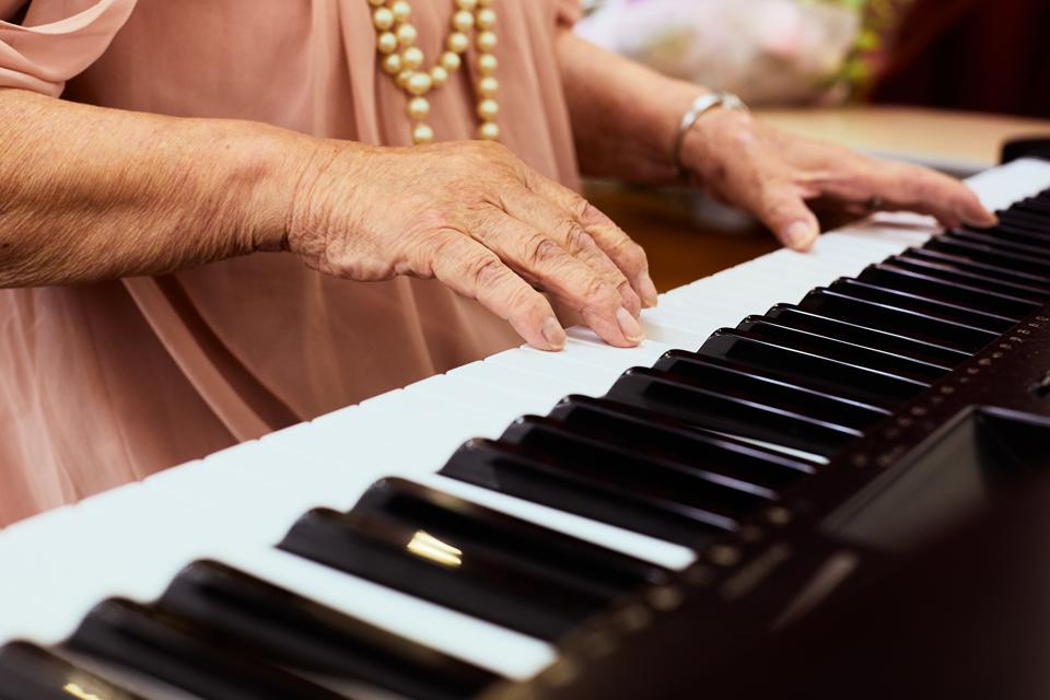 Senior Woman playing the piano