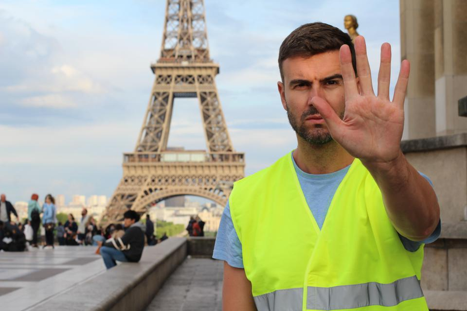 Man with yellow vest protesting in France