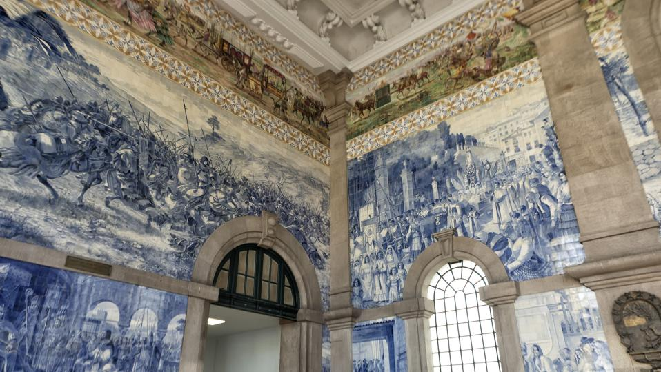 The São Bento railway station in Porto showcases classic Portuguese azulejo tiles in all their Classic Blue glory.