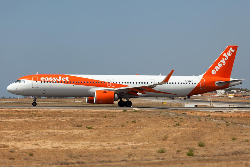 An easyJet Airbus 321 NEO seen at holding point of Faro...