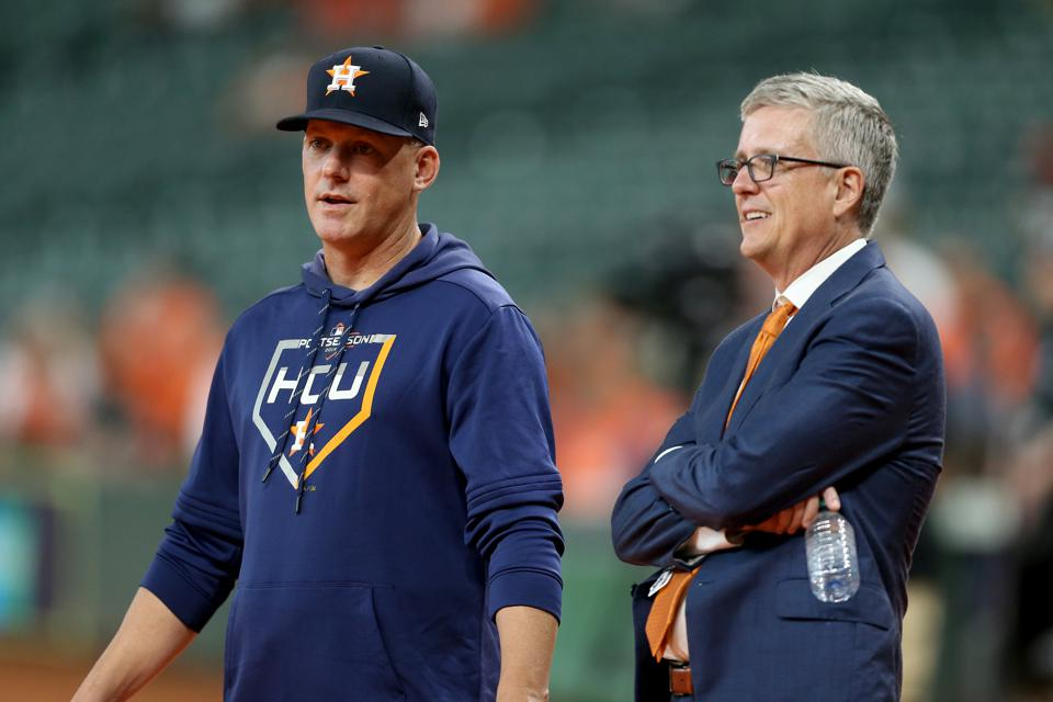 Astros manager AJ Hinch and general manager Jeff Luhnow