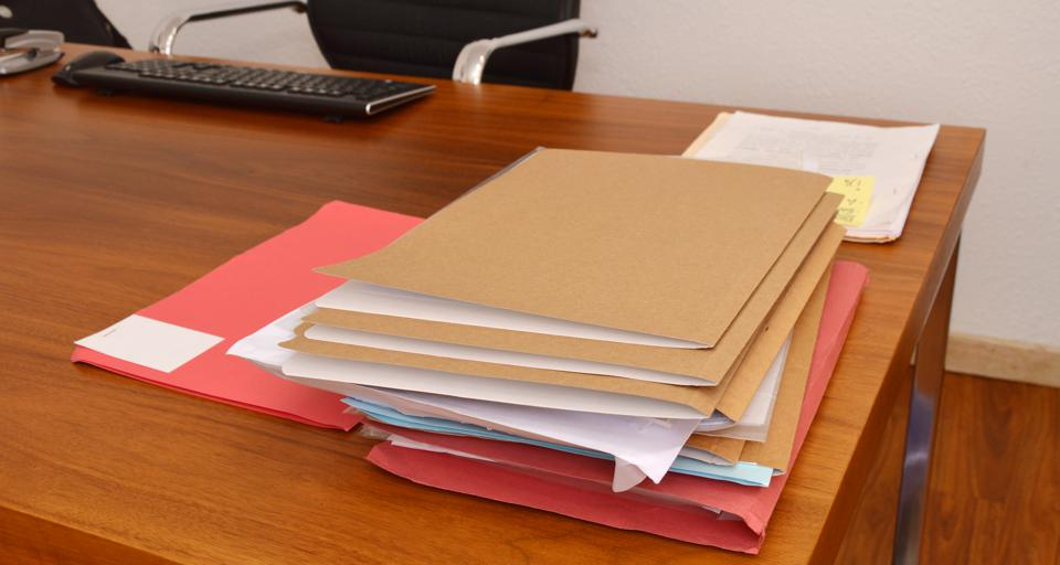 Papers Piled on Desk