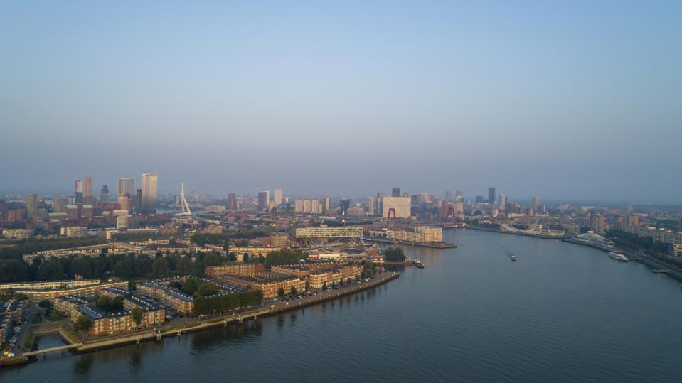 Rotterdam Skyline with Erasmus Brug bridge at sunset in morning in Rotterdam, Netherlands