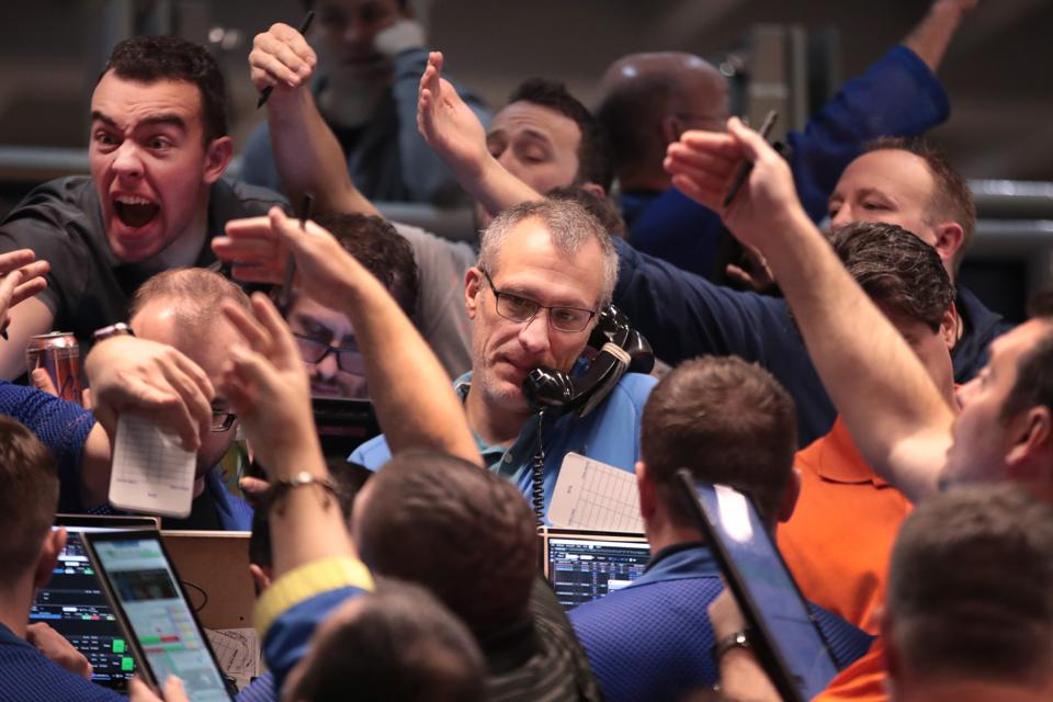 Traders Work On The Floor Of The CBOE Global Markets