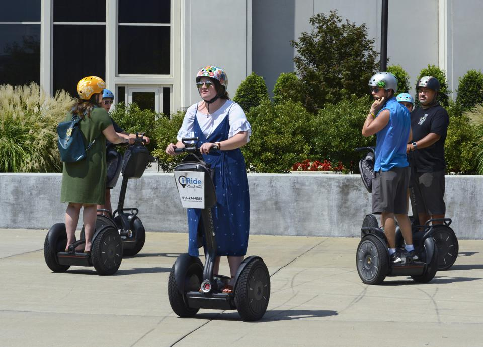 Tourists ride Segway PTs in Nashville, Tennessee USA