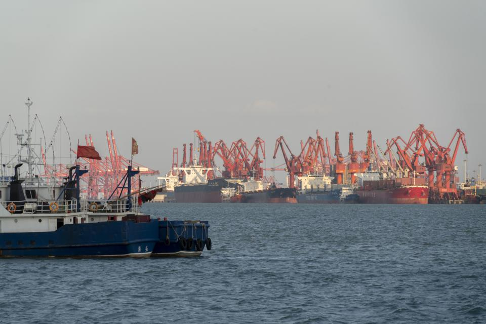 Container ships and freight cranes in Lianyungang port.