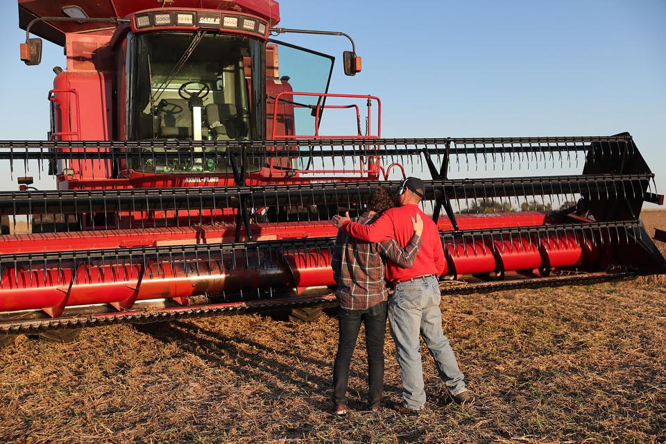 Tim Bardole hugs his son Gabe Bardole during the soybean harvest at the Bardole & Son's farm last October in Rippey, Iowa. October and November are critical months for soybean exports, and both were historically low the last two years.