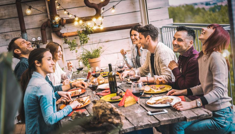 Friends and family enjoying Italian wine al fresco