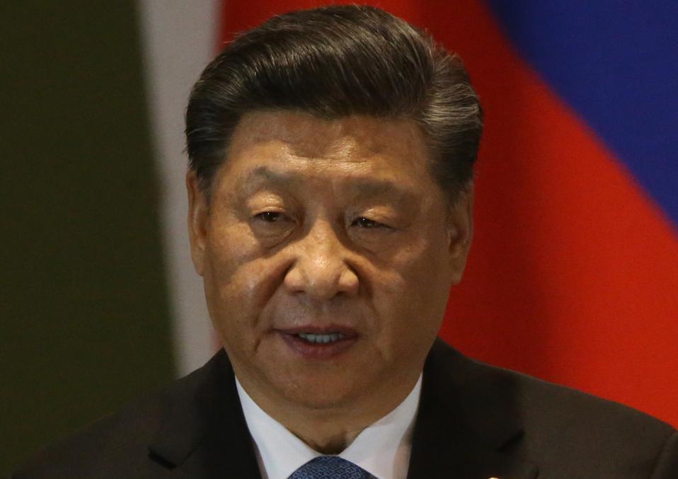 Russian President Vladimir Putin and Chinese President Xi Jinping attend the BRICS Summit in Brasilia