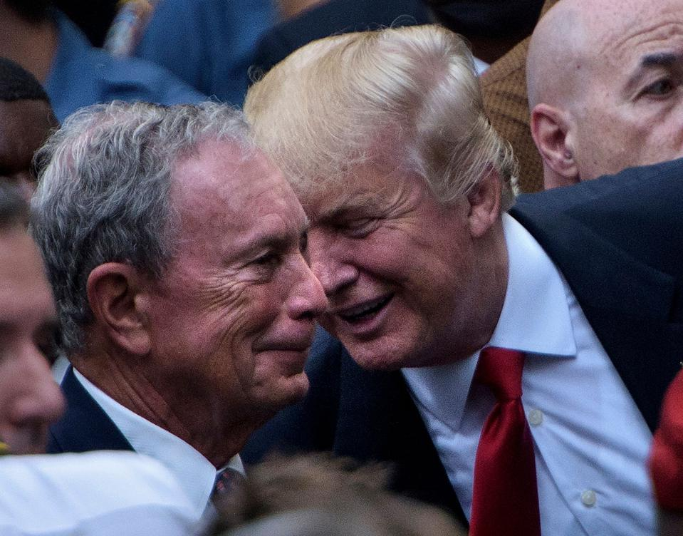The presidential nominee Donald Trump spoke to former New York City Mayor Michael Bloomberg during a memorial service at the National 9/11 Memorial September 11, 2016 in New York.