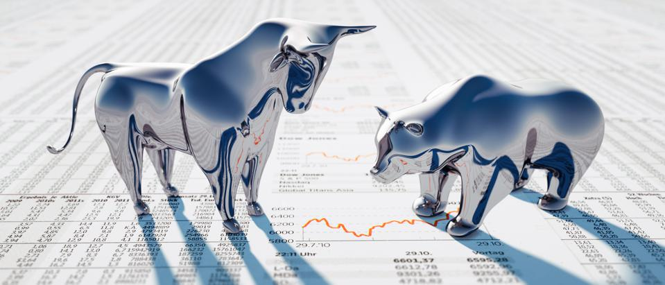Silver Bull and Bear on Newspaper
