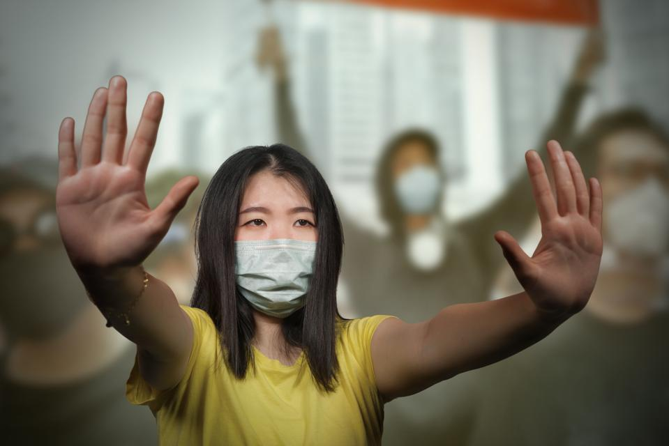 young woman showing clean hands as symbol of social justice