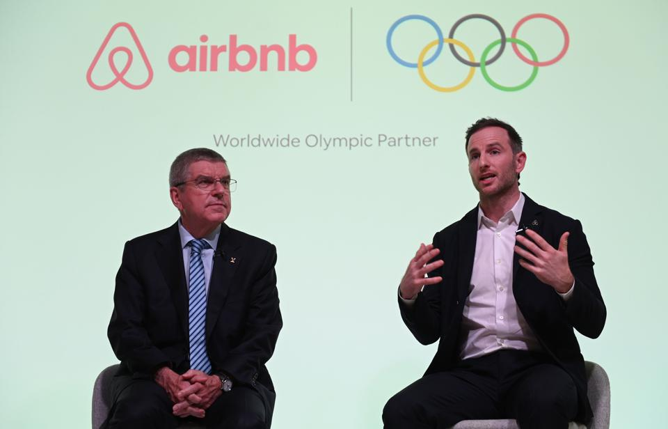 International Olympic Committee (IOC) President Thomas Bach (L) and Airbnb co-founder Joe Gebbia.