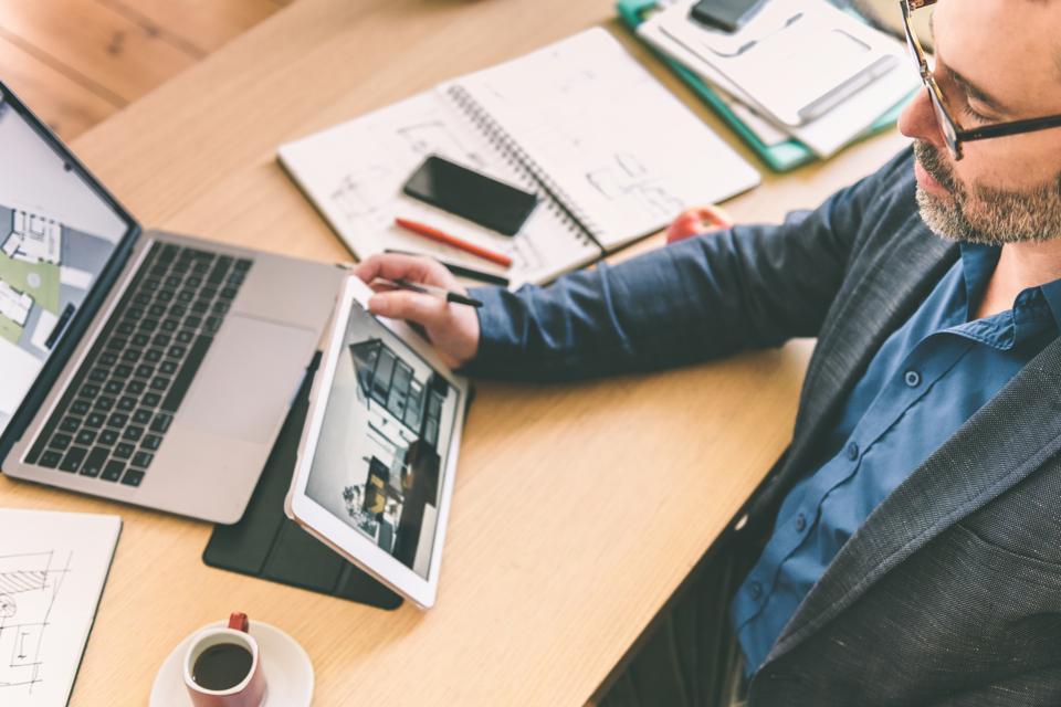 architect holding digital tablet at work desk