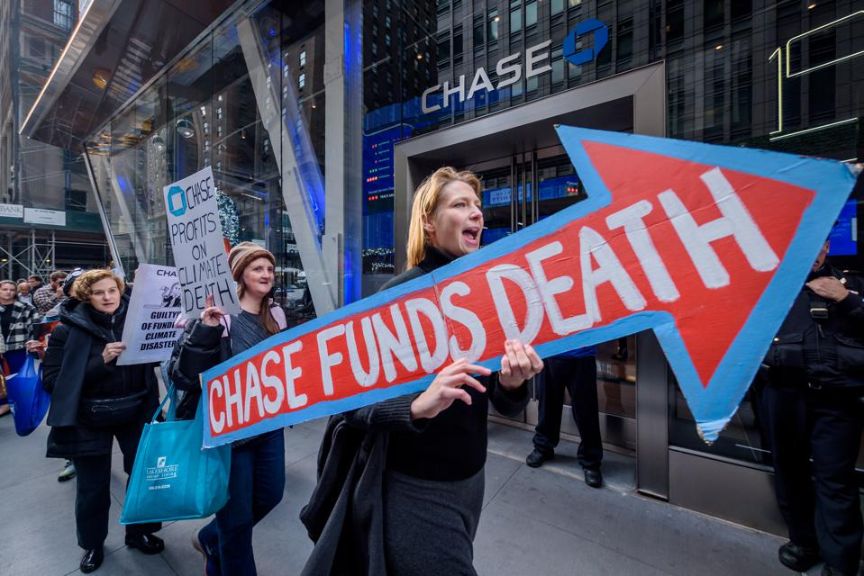Protesters picketing outside a Chase Bank branch.
