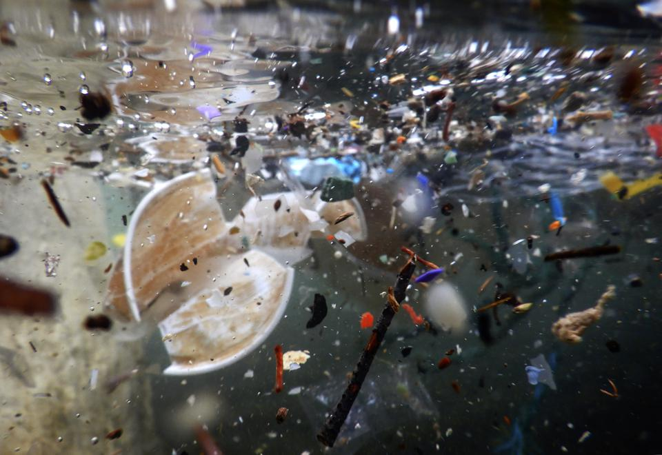 Plastic waste and debris underwater carried by the storm of...
