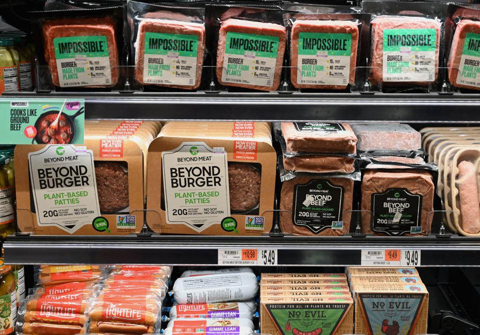 Plant-based alternatives from Impossible Foods and Beyond Meat sit on a shelf for sale in New York City.