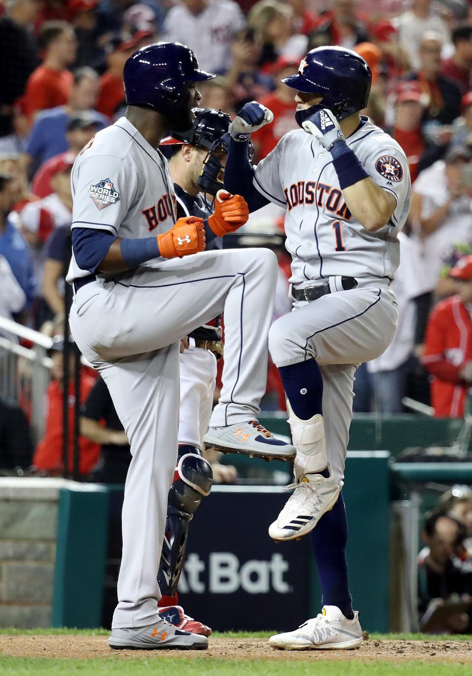 Carlos Correa of the Houston Astros is congratulated by his teammate Yordan Alvarez.