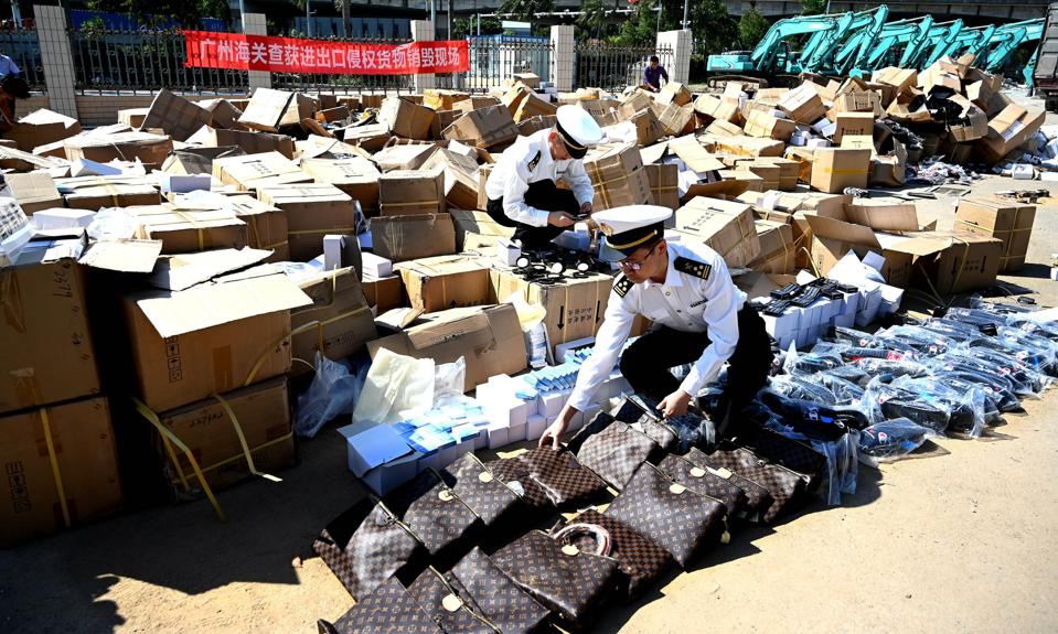 Police Destroy Infringing Products In Guangzhou