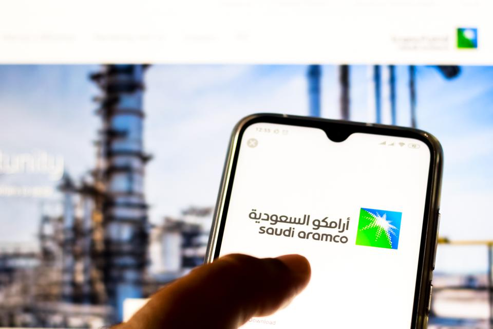 In this photo illustration the Saudi Arabian Oil Company (...