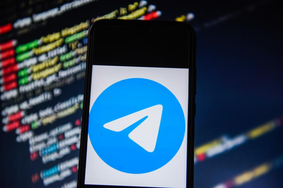 In this photo illustration a Telegram logo  seen displayed...