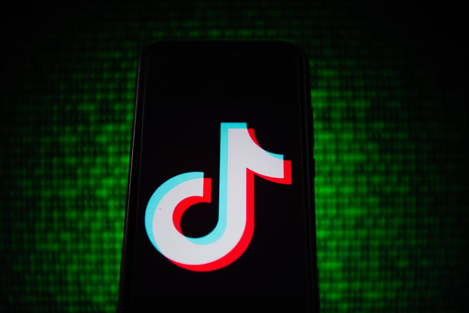 In this photo illustration a TikTok logo seen displayed on a...