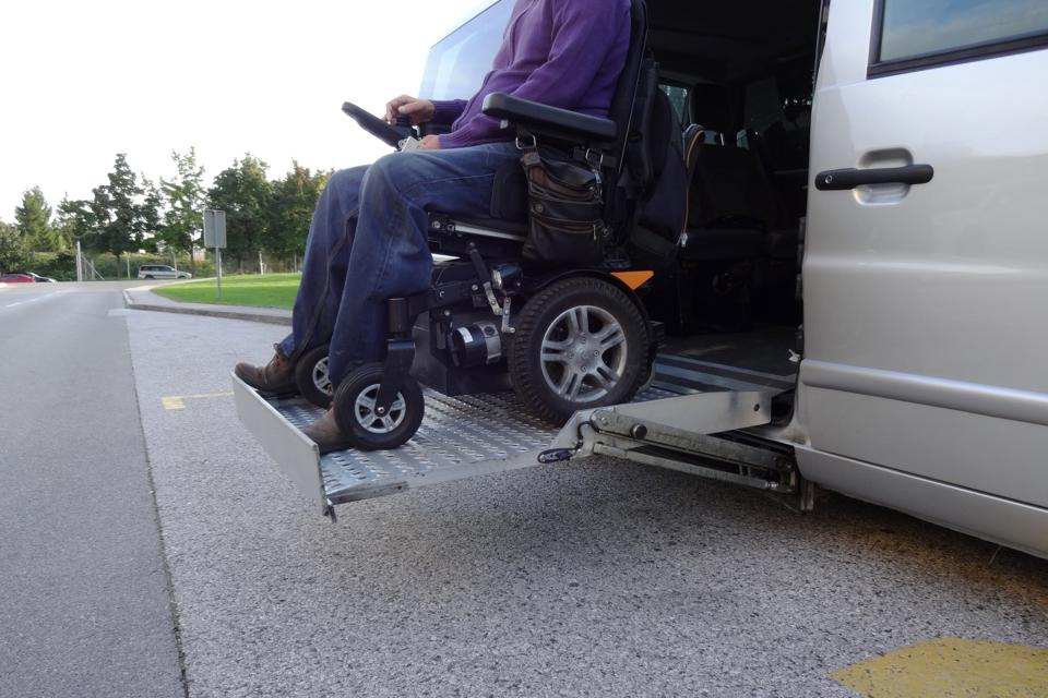 Disabled Man on Wheelchair using vehicle