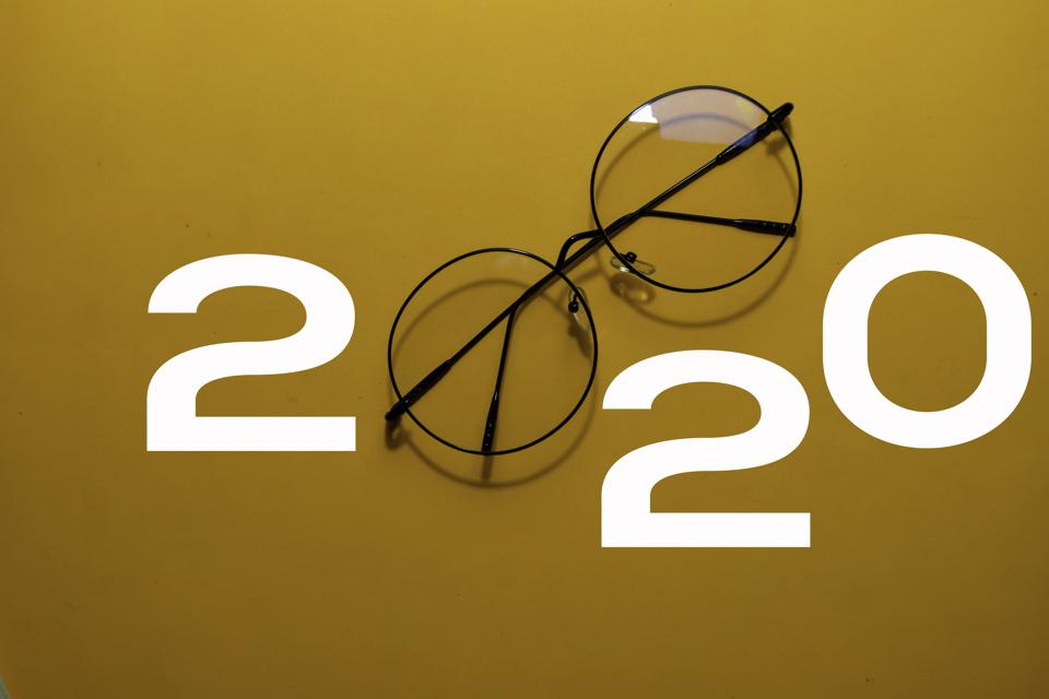 Happy New Year 2020 with Glasses isolated on yellow background