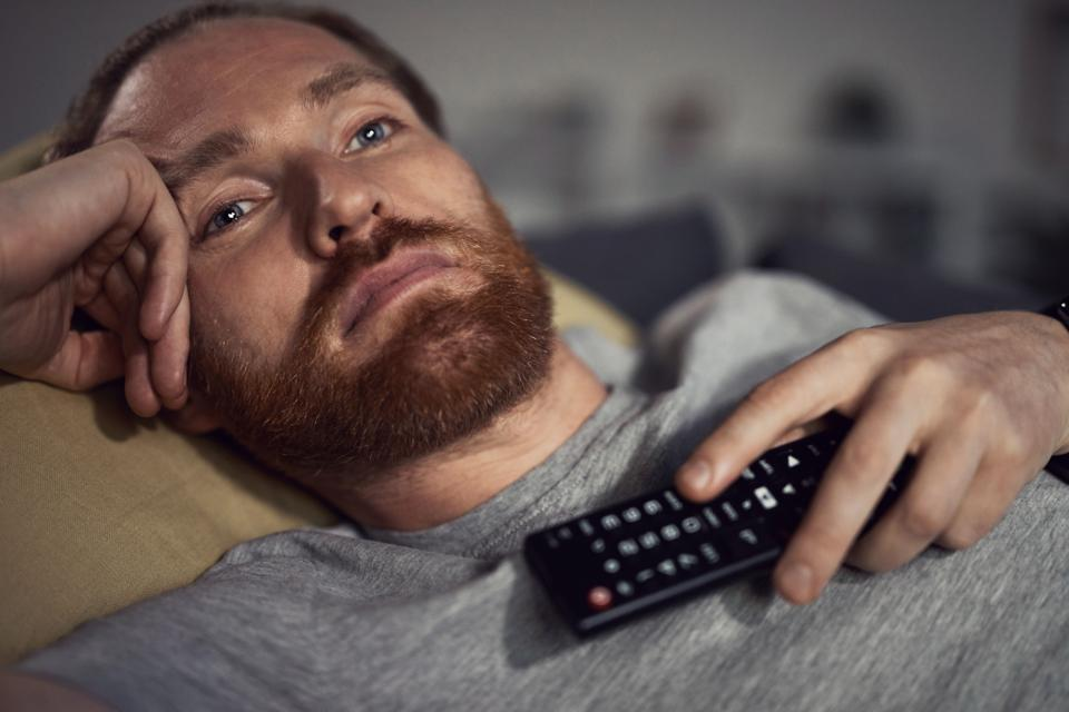 Sleepy Man Watching TV on Couch