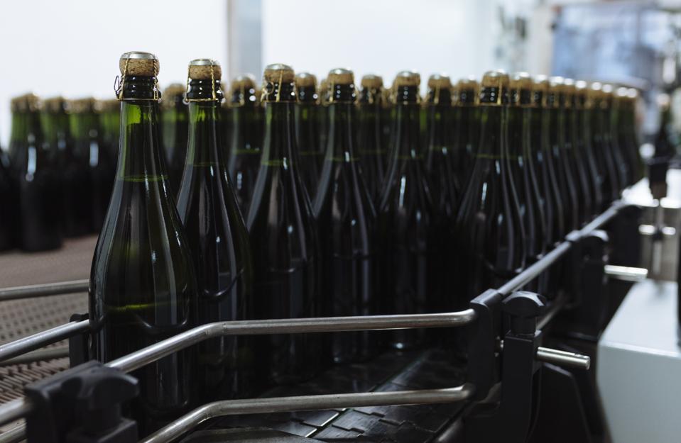 Bottles of Cava on conveyor