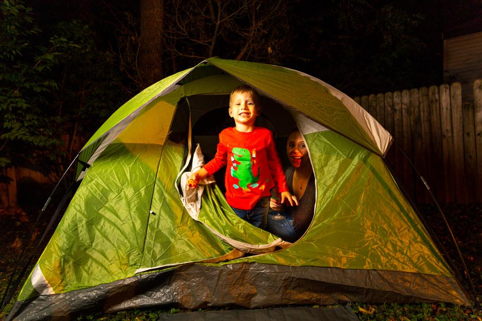 2 Little Boys Play Together With Their Moms in their Backyard in a Green Camping Tent At Night