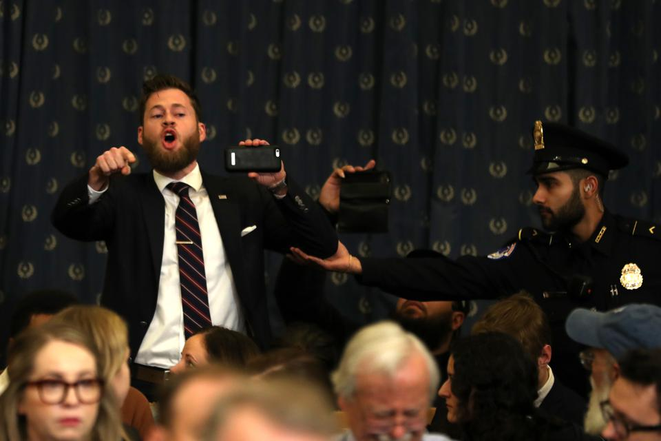 Owen Shroyer, an InfoWars host, disrupts Monday's judiciary committee impeachment hearing.