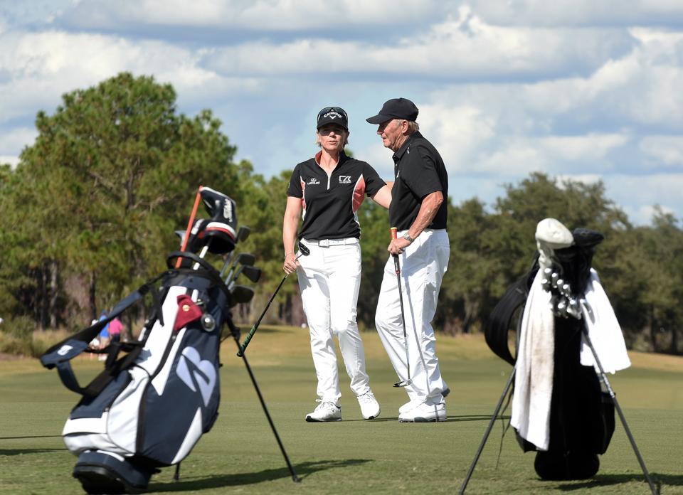 Swedish golfer Annika Sorenstam (left) embraces her father,...