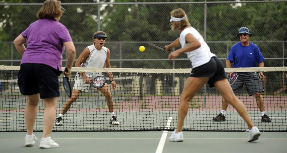 Retirees playing pickleball