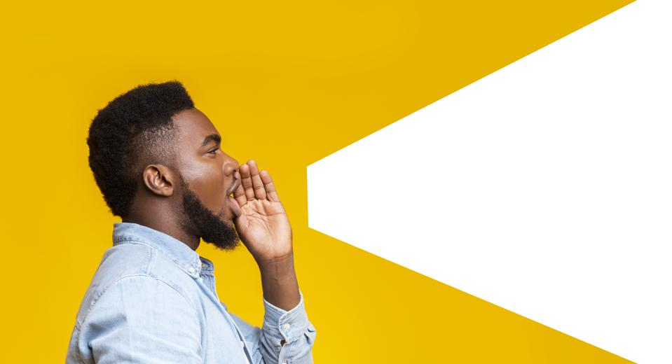 Guy making loud announcement at copy space on yellow background