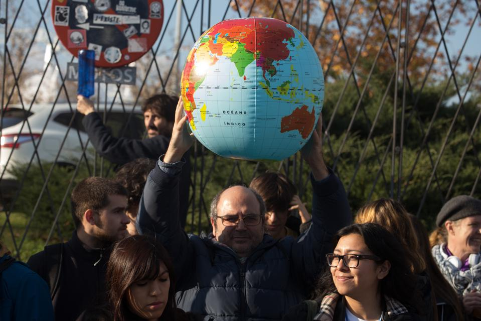 An activist holds the Earth balloon during the demonstration...