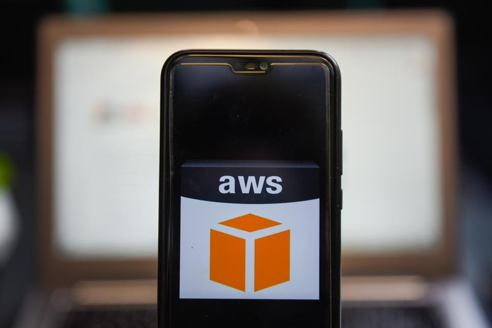 In this photo illustration an Amazon Web Service logo seen...