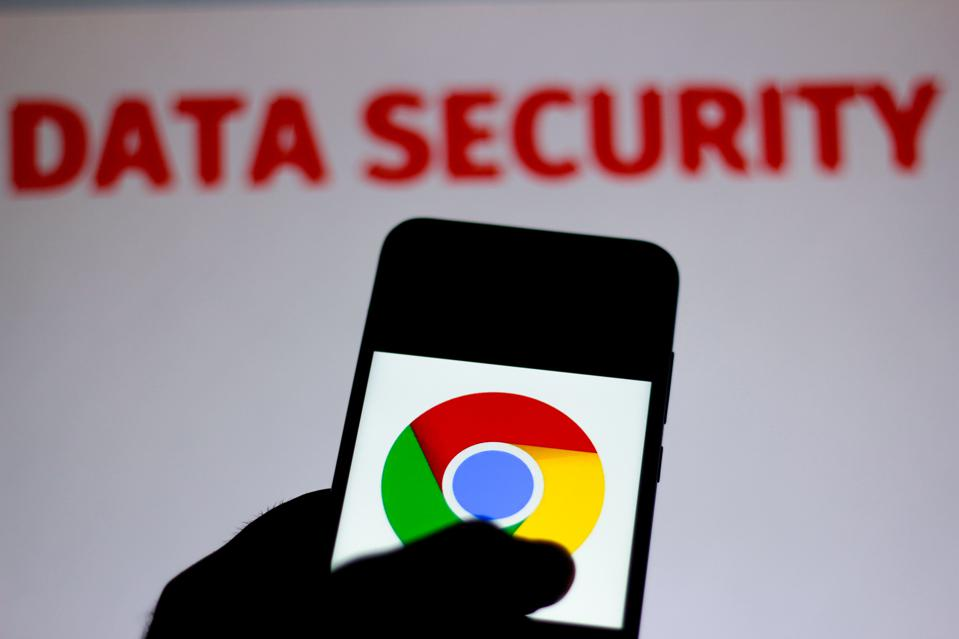 The Google Chrome logo on a smartphone against a blurred backdrop saying 'data security'