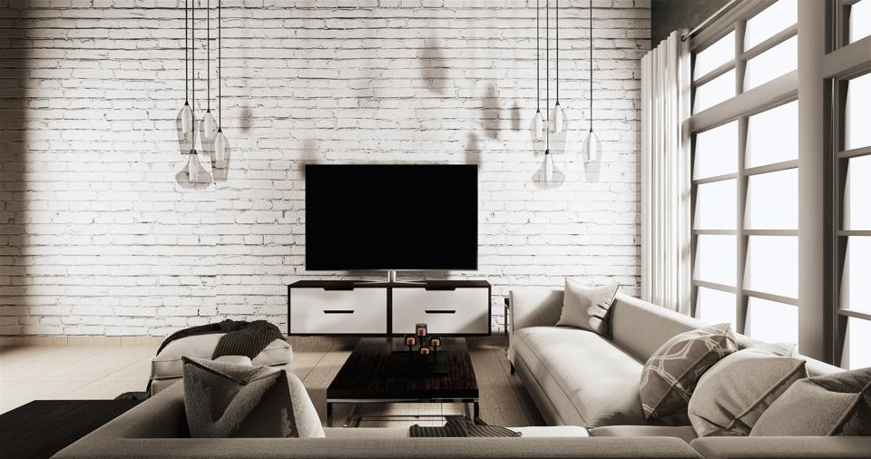 Smart Tv on Cabinet in Living room Loft style with white brick wall on wooden floor and sofa armchair.3D rendering