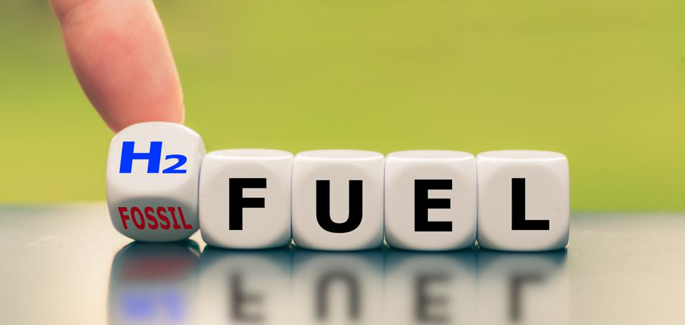 Hand turns a dice and changes the expression ″fossil fuel″ to ″H2 fuel″